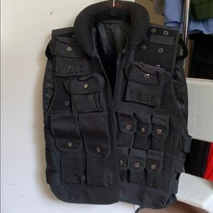 Military black vest / tactical vest.